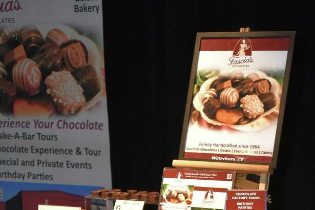 The Warner Theatre will hold its 18th Annual Wine & Food Tasting from 6-9 p.m. Oct. 25. Above, a participant from the 2018 event offers specialty chocolates.