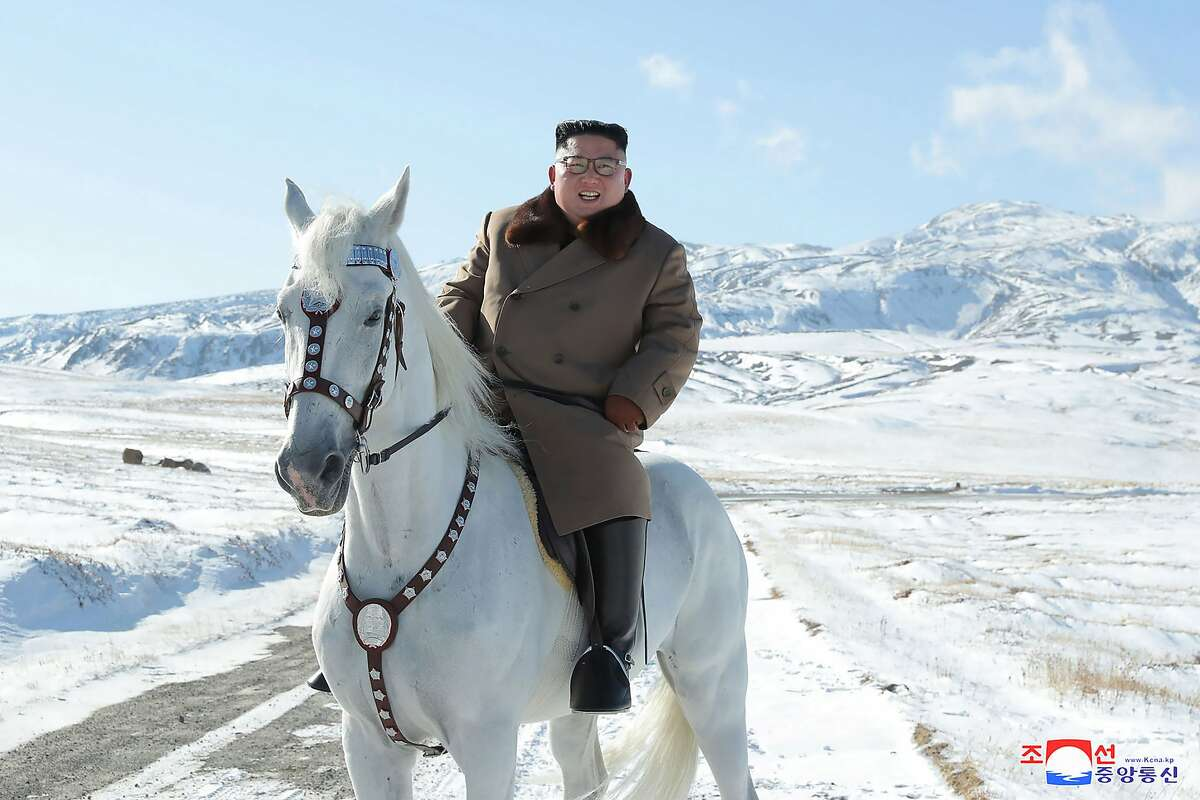 In this undated photo provided on Wednesday, Oct. 16, 2019, by the North Korean government, North Korean leader Kim Jong Un rides a white horse to climb Mount Paektu, North Korea. Independent journalists were not given access to cover the event depicted in this image distributed by the North Korean government. The content of this image is as provided and cannot be independently verified. Korean language watermark on image as provided by source reads: