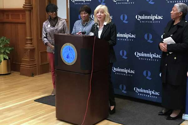 Quinnipiac University President Judy Olian announces a partnership between the university and the New Haven Promise on Oct. 16, 2019.