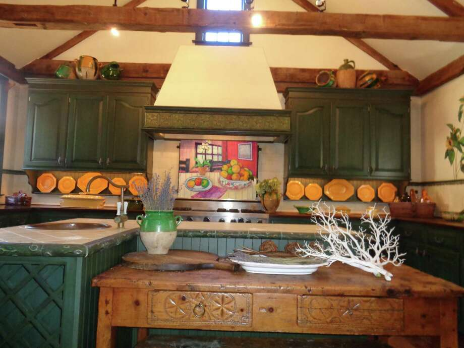 The kitchen of the free-standing Bed and Breakfast is decorated by the work of local artists that are for sale. Most recently, the French Modernist paintings by Christian Cesari of Woodbury were featured. Photo: Jo-Ann Jaacks / Contributed Photo /
