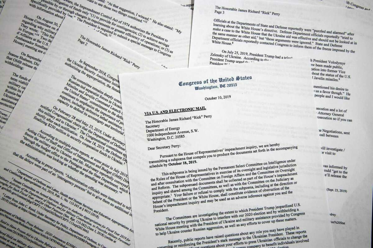The subpoena from the House Permanent Select Committee on Intelligence to Energy Secretary Rick Perry on Thursday, Oct. 10, 2019, is photographed in Washington. House Democrats have subpoenaed Perry as part of their impeachment investigation into President Donald Trump's dealings with Ukraine. (AP Photo/Jon Elswick)