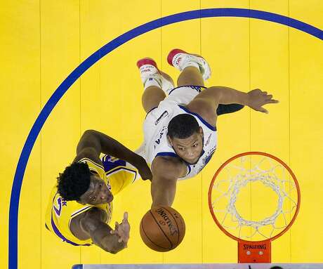 Omari Spellman (4) blocks a shot by Devontae Cacok (12) in the second half as the Golden State Warriors played the Los Angeles Lakers in a pre-season game at Chase Center in San Francisco, Calif., on Saturday, October 5, 2019.