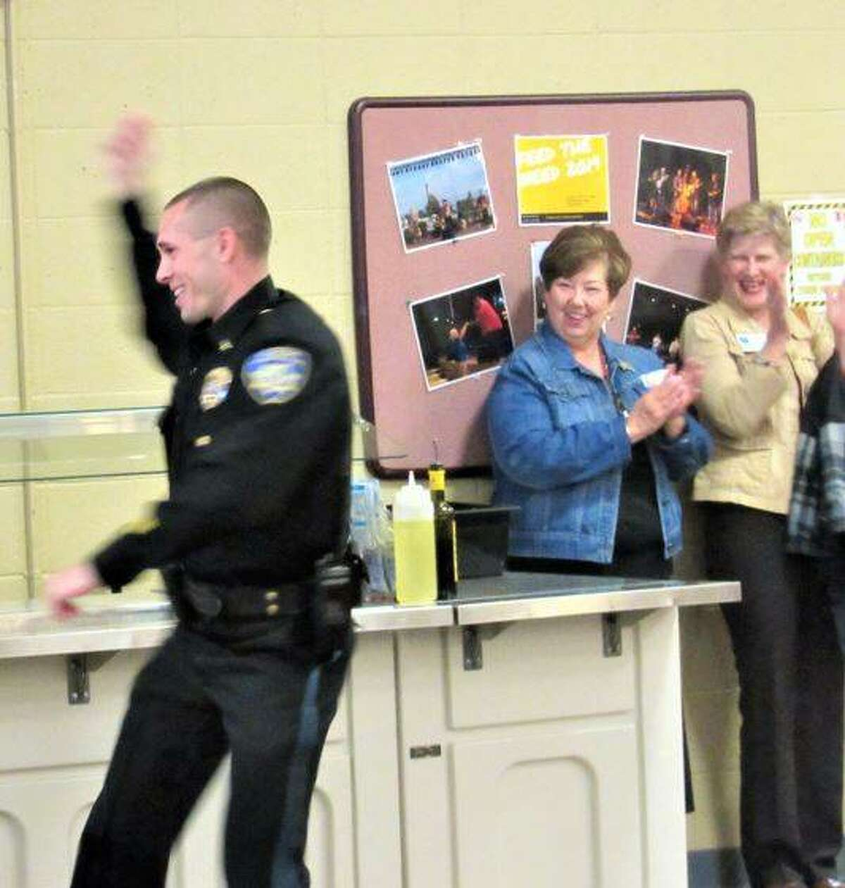 """Alton Police Lt. Jarrot Ford """"cracking that whip"""" during a first responders style show Wednesday as part of the Older Adults Health Council Fall Health Fair at SSP."""