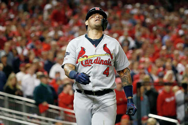 The Cardinals' Yadier Molina reacts after being hit by a pitch in the eighth inning of Game 4 of NLCS against the Nationals Tuesday in Washington.