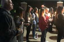 Dozens gathered for a candlelight vigil at Riverwalk Oct. 15 to remember those lost and celebrate the survivors of domestic violence.