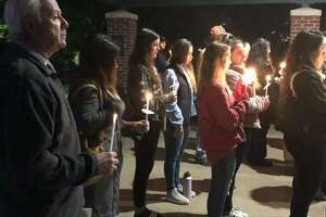 Dozens gathered for a candlelight vigil Tuesday at Riverwalk to remember those lost and celebrate the survivors of domestic violence.