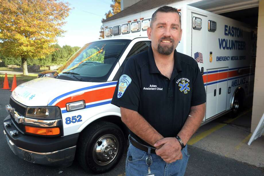 Adam Goldstein, assistant chief for Easton EMS, poses next to an ambulance in Easton, Conn. Oct. 15, 2019. Goldstein has been on dialysis for 11 years, and has renewed his effort to find a potential living donor for a new kidney. Photo: Ned Gerard / Hearst Connecticut Media / Connecticut Post
