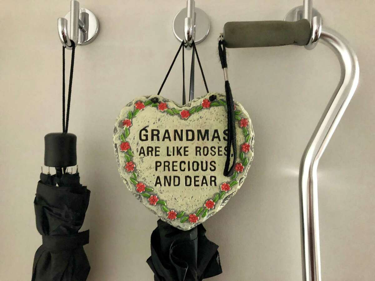 Elsie Cruey, 83, has been told she must vacate her apartment, where she hangs this decoration, by Thursday, Oct. 17, 2019. Among her lease violations is a claim that she took too many cookies from a community event.