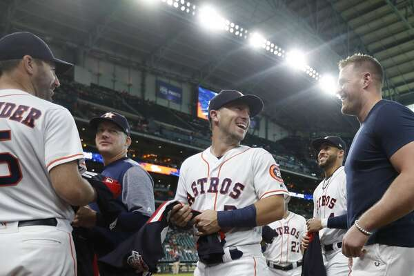 Houston Texand J.J. Watt with Alex Bregman, after he handed out All-Star jerseys before the start of an MLB game at Minute Maid Park, Thursday, July 12, 2018, in Houston. ( Karen Warren / Houston Chronicle )