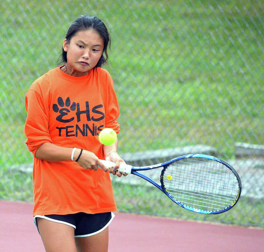 Edwardsville freshman Chloe Koons hits a two-handed backhand during her No. 2 doubles match on Tuesday in the Southwestern Conference Tournament at the EHS Tennis Center.