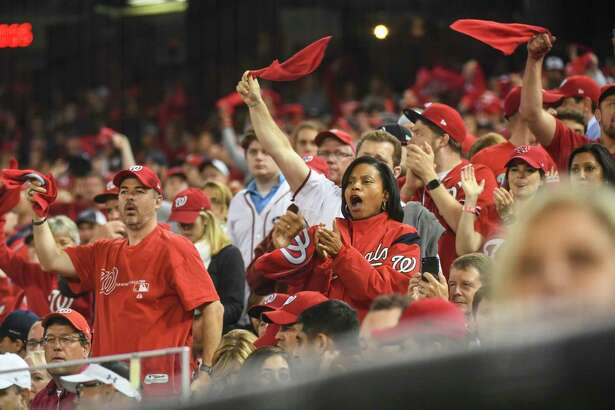 Washington Nationals fans cheer on the team during the fifth inning Tuesday's Game Four of the NLCS against the St. Louis Cardinals at Nationals Park. MUST CREDIt: Washington Post photo by Toni L. Sandys