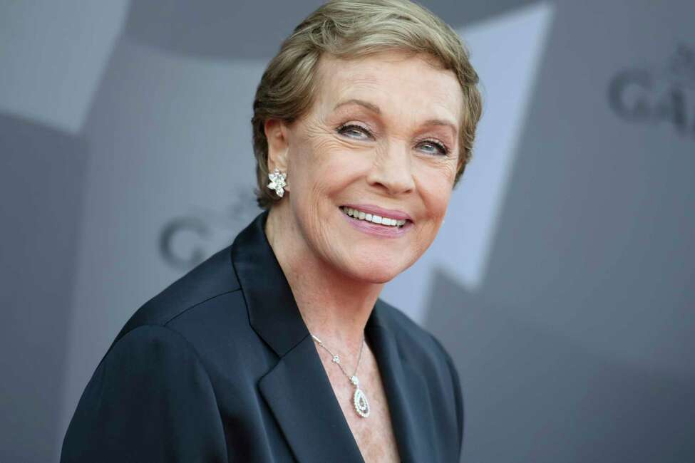 FILE - In this Sept. 29, 2015 file photo, actress Julie Andrews arrives at the Los Angeles Philharmonic 2015/2016 season opening gala at Walt Disney Concert Hall in Los Angeles. Andrews released a memoir, a€œHome Work: A Memoir of My Hollywood Years,a€ which hits shelves on Oct. 15, 2019. (Photo by Richard Shotwell/Invision/AP, File)