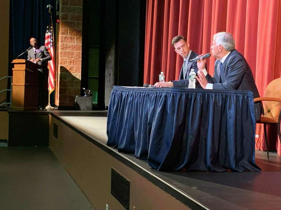 Middletown mayoral candidates Ben Florsheim, left, and Common Council Minority Leader Sebastian N. Giuliano answer questions from the audience during a forum Oct. 3 at Middletown High School. Photo: Contributed Photo