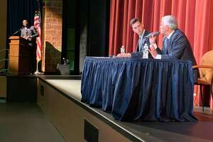 Middletown mayoral candidates Ben Florsheim, left, and Common Council Minority Leader Sebastian N. Giuliano answer questions from the audience during a forum Oct. 3 at Middletown High School.
