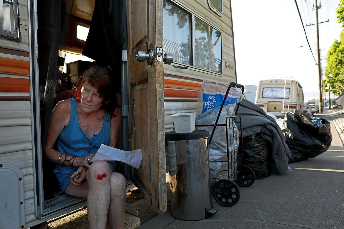 """Eileen Mulcahy, 57, sits in her RV near 85th Ave. and Baldwin St. in Oakland, Calif., on Thursday, June 20, 2019. """"There are so many abandoned buildings and abandoned warehouses that could be like given to us ... to get us off the streets and maybe to empower us, to be able to say, 'Okay, this could be ours.'"""" Mulcahy said. """"Millions of dollars was allocated for the homeless. A little bit went to the tuff sheds, that's like concentration camps to me because you're being watched."""""""