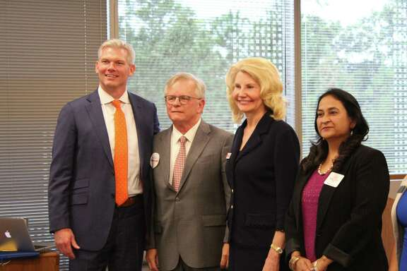 Ten of the 11 candidate for the three open seats on The Woodlands Township Board of Directors election were on hand Tuesday, Oct. 15, at a forum hosted by The Woodlands Area Chamber of Commerce. These are the Position 5 candidates with JJ Hollie, on left, from the Chamber: Walter Cooke, second from left, Shelley Sekula-Gibbs, and Rashmi Gupta, on far right.