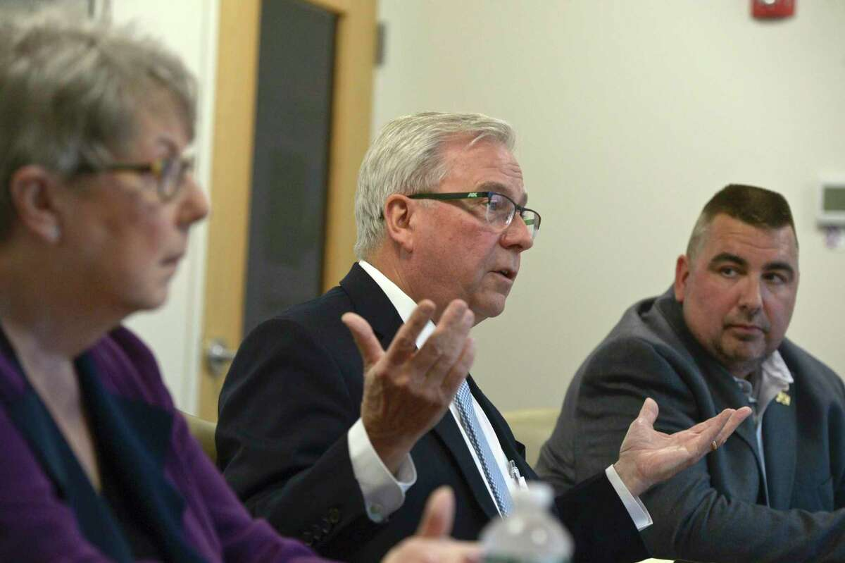Candidates for Bethel First Selectman, Democratic incumbent Matt Knickerbocker, center, Republican challenger Pat Rist, left, and unaffiliated candidate Bill Ochs during the News Times editorial board interview. Wednesday, October 16, 2019, in Danbury, Conn.