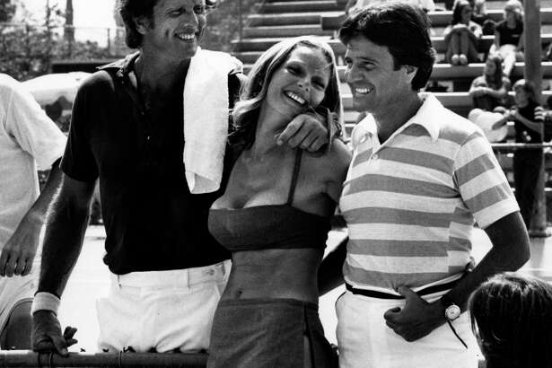 NEW YORK CITY - JUNE 25: Actor Ron Ely, wife Valerie Lundeen and Joe Lacovetta attend Third Annual Cathy's Pro-Celebrity Tennis Classic on June 25, 1977 at Billy Jean King Tennis Stadium at Forest Hills in New York City. (Photo by Ron Galella, Ltd./Ron Galella Collection via Getty Images)