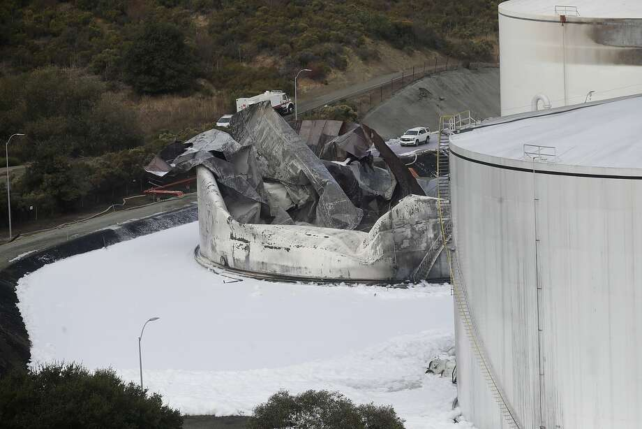 Damage from a Tuesday, Oct. 15, 2019, fire is shown at NuStar Energy fuel storage facility in Crockett, Calif., Wednesday, Oct. 16, 2019. Officials were trying to determine Wednesday if a 4.5 magnitude earthquake triggered an explosion at the fuel storage facility in the San Francisco Bay Area that started a fire and trapped thousands in their homes for hours because of potentially unhealthy air. (AP Photo/Jeff Chiu) Photo: Jeff Chiu / Associated Press