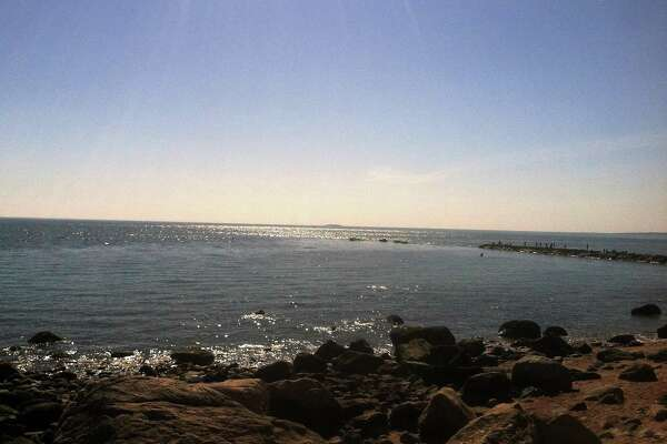 "In a 1996 State of the Town address, former First Selectman Thomas ""Tom"" Rylander expressed pride in the town's school system and its beach and recreation programs. Here, Hammonasset Beach State Park."