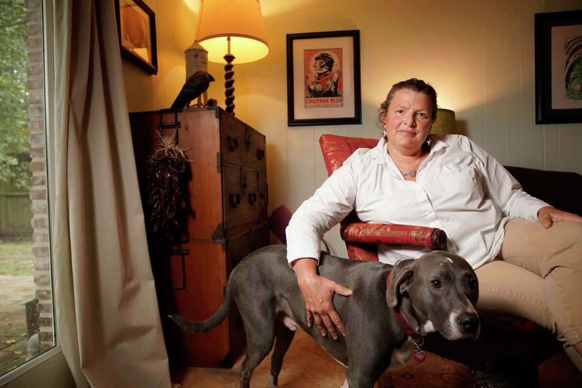 Betsy Evans with her dog, Baxter, at her home Wednesday, Oct. 16, 2019, in Houston. She is a cancer survivor who has been diagnosed with four different cancers in past three and a half years. She is among those who got a letter saying her in-network coverage with Community Health Choice will no longer include Kelsey Seybold Clinics where she has been undergoing treatment.