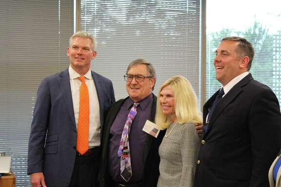 """The Position 6 candidates for The Woodlands Township Board of Directors election pose with Chamber CEO JJ Hollie (left). Next to Hollie (from left) are: Alan Richel, incumbent Ann Snyder and Thomas Chumbley. A fourth candidate for the seat, Luis """"Louis"""" Granados, was not at the forum. Three of the candidates addressed the audience at the Chamber offices in The Woodlands."""