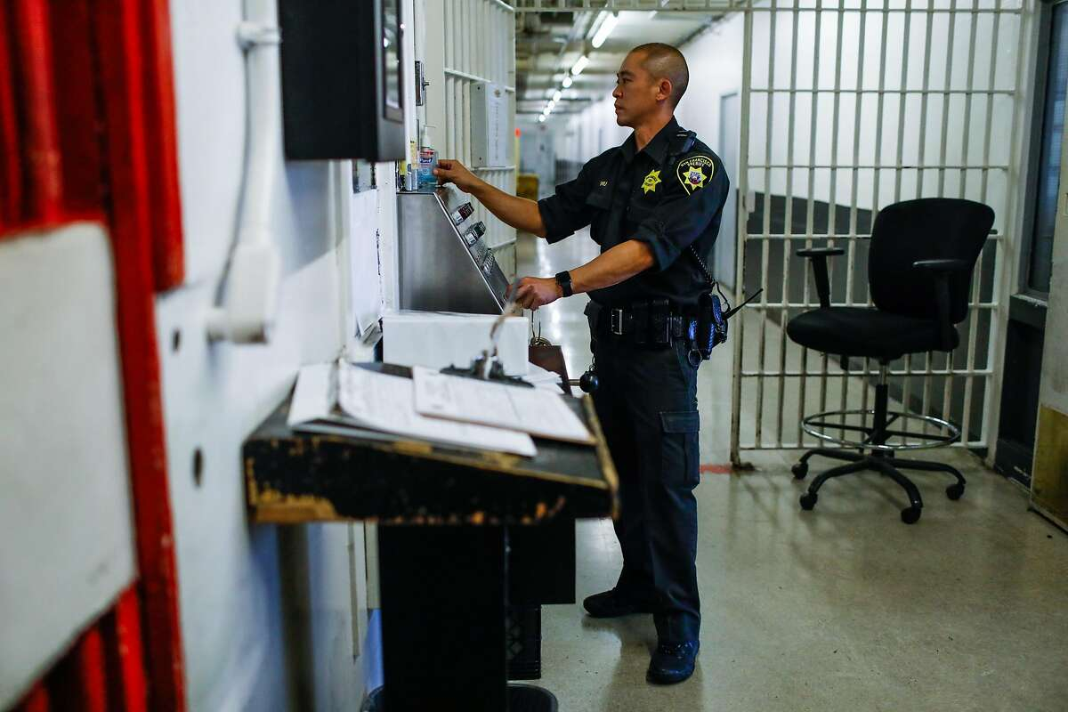 A sheriff monitors County Jail 4 in the Hall of Justice in San Francisco, California, on Thursday, Nov. 1, 2018.
