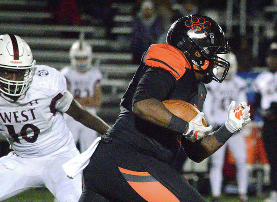 Edwardsville running back Malachi Revis finds room against the Belleville West defense. Photo: Scott Marion|The Intelligencer