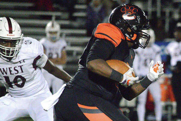 Edwardsville running back Malachi Revis finds room against the Belleville West defense.