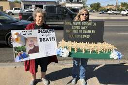 Wanda Lackey, left, and her daughter, Gina Bruton, organized Midland Don't Punish Pain rally, which was Wednesday afternoon in front of the Drug Enforcement Administration office on Big Spring Street.