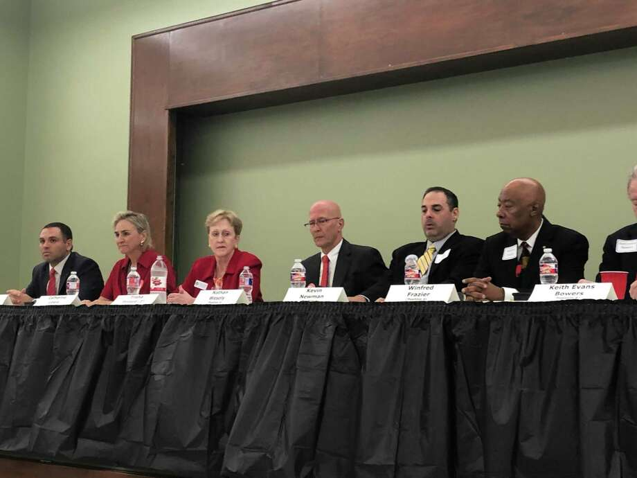 Bellaire City Council candidates Andrew Friedberg (from left), Catherine Lewis, Trisha Pollard, Nathan Wesely, Kevin Newman and Winfred Frazier discuss issues facing their city at the Bellaire Candidates Forum on Tuesday, Oct. 15, at the Bellaire Civic Center. Other candidates not pictured: Robert Riquelmy, Keith Bowers, Jim Hotze and David Montague. Photo: Tracy Maness