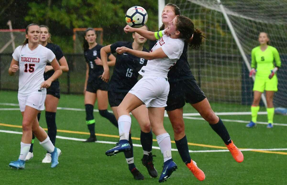 Wrecker #27 Charlotte Barnes and Tiger #11Caitlin Slaminko battle for the ball as The Staples High School Wreckers takes on the Ridgefield High School Tigers in the FCIAC girls soccer game Wednesday, October 16, 2019, in Westport, Conn.