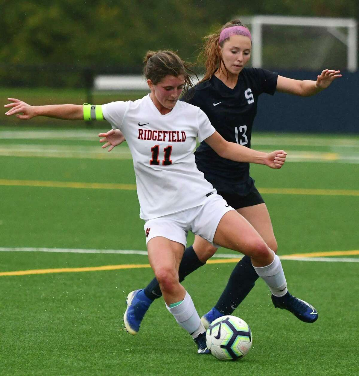 Tiger #11Caitlin Slaminko and Wrecker #13 Alexa Frost battle for the ball as The Staples High School Wreckers takes on the Ridgefield High School Tigers in the FCIAC girls soccer game Wednesday, October 16, 2019, in Westport, Conn.