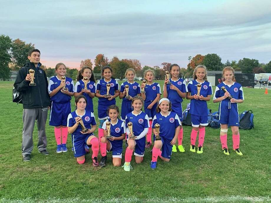 The Norwalk Junior Soccer Association's U11 girls team captured its division last weekend at the Columbus Day Tournament in Rocky Hill. Photo: Contributed Photo