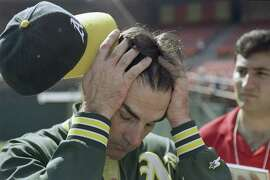 Oakland A's manager Tony LaRussa runs his hands through his hair as he talks of the earthquake tragedy during A's workout, Thursday, Oct. 19, 1989 at the Oakland Coliseum. The World Series resumes on Tuesday at San Francisco's Candlestick Park. This was Athletics' first workout since the quake. (AP Photo/Jack Smith)