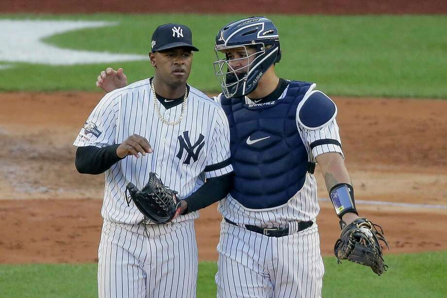 New York Yankees catcher Gary Sanchez talks on the mound with starting pitcher Luis Severino (40) during the fourth inning of Game 3 of baseball's American League Championship Series against the Houston Astros, Tuesday, Oct. 15, 2019, in New York. (AP Photo/Seth Wenig) Photo: Seth Wenig / AP