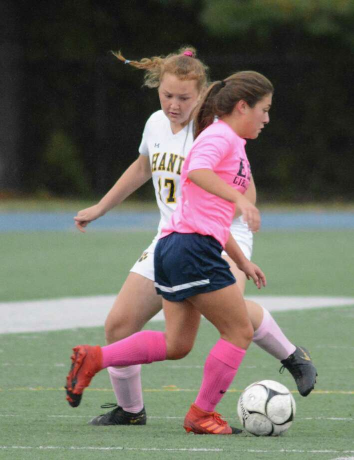 Hand's Delanie Rourke, rear, and East Haven's Gianna Mendez battle for the ball on Tuesday. Photo: Dave Phillips / For Hearst Connecticut Media