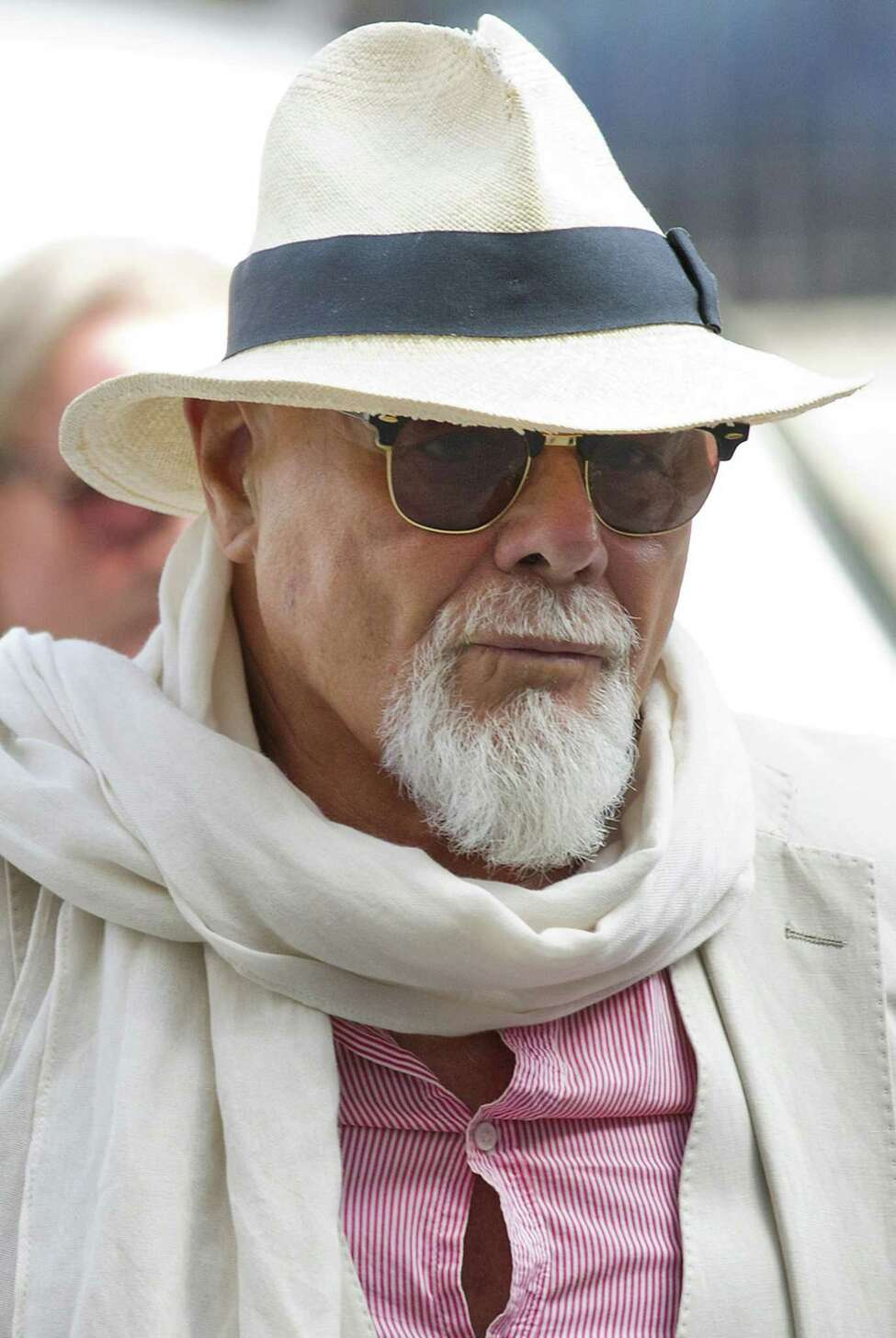 (FILES) In a file picture taken on June 19, 2014 British former pop star Gary Glitter, whose real name is Paul Gadd, arrives at Westminster Magistrates Court in London. Gad denied a string of sex offences against three underage girls as he appeared in a London court on November 11, 2014 and will face trial in January 2015. The 1970s glam rocker faces a total of 10 charges related to the alleged crimes committed between 1975 and 1980. AFP PHOTO / JUSTIN TALLISJUSTIN TALLIS/AFP/Getty Images ORG XMIT: 1711