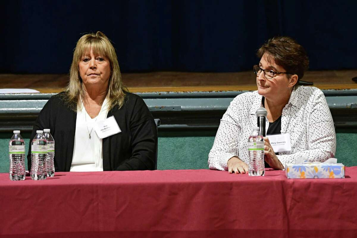 Kimberly Ashe-McPherson, left, and Mary Sweeney answer questions during a council race debate sponsored by Troy Neighborhoods Action Council (TNAC) at Troy Prep Elementary on Wednesday, Oct. 16, 2019 in Troy, N.Y. (Lori Van Buren/Times Union)