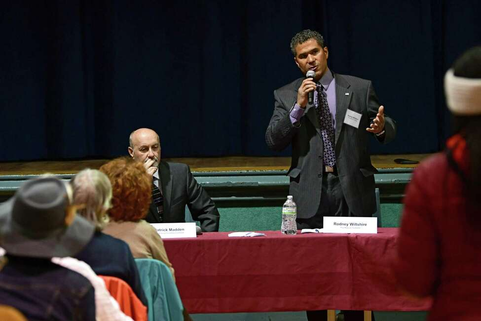 Rodney Wiltshire, a former council president, right, speaks during a mayoral debate with Mayor Patrick Madden at Troy Prep Elementary on Wednesday, Oct. 16, 2019 in Troy, N.Y. The debate was sponsored by Troy Neighborhoods Action Council (TNAC). (Lori Van Buren/Times Union)