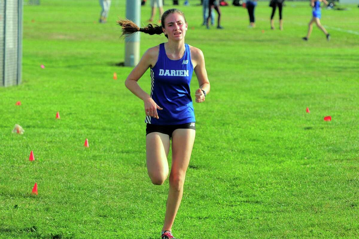 Darien's Mairead Clas comes in first against Trumbull in September.