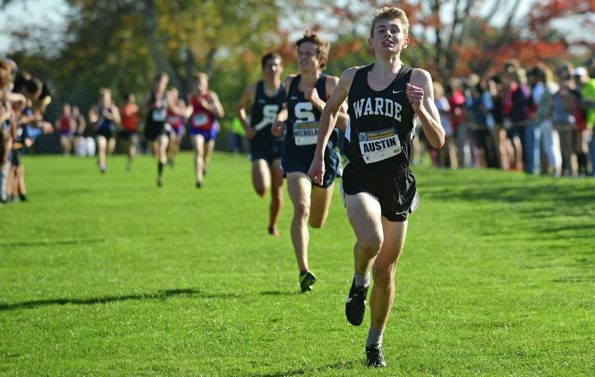 Fairfield Warde's Austin Hutchens comes in second during the FCIAC championships Tuesday at Waveny Park in New Canaan.