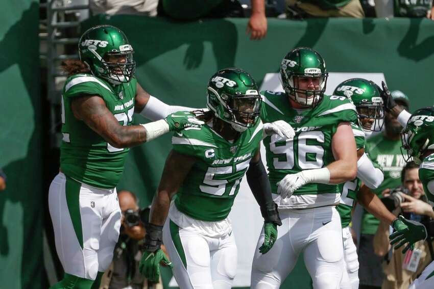 New York Jets inside linebacker C.J. Mosley (57) celebrates with teammates after running back an interception for a touchdown during the first half of an NFL football game against the Buffalo Bills Sunday, Sept. 8, 2019, in East Rutherford, N.J. (AP Photo/Seth Wenig)
