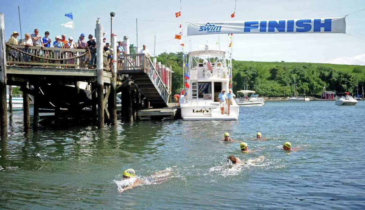 Members of the team LLBH Private Wealth Management finish the Swim Across the Sound Marathon first at Captain's Cove Seaport on Saturday, August 7, 2010. Team members include Matthew Watson of Fairfield, Patrick White of Stamford, Christopher Lietzow of Aiken, Costas Hadjipateras of New Canaan, Trevor Healy of New Canaan and Devon Healy of New Canaan.