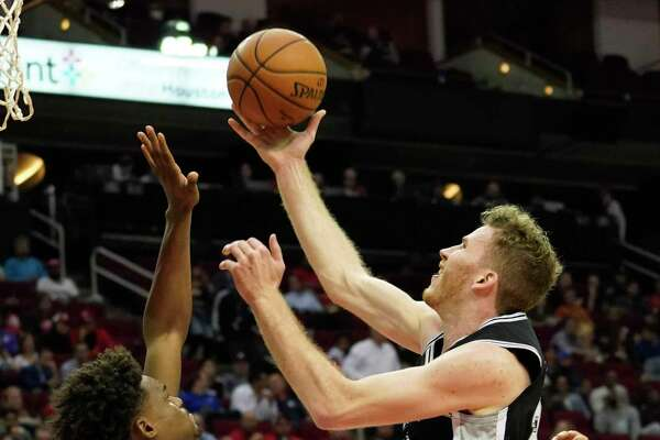 San Antonio Spurs Jakob Ploeltl goes to the basket and draws a foul from Houston Rockets Danuel House Jr. during the first half of NBA game at Toyota Center Wednesday, Oct. 16, 2019, in Houston.