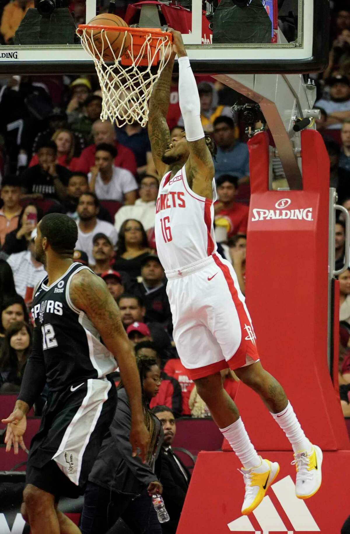 Houston Rockets Ben McLemore dunks the ball past San Antonio Spurs LaMarcus Aldridge during the first half of NBA game at Toyota Center Wednesday, Oct. 16, 2019, in Houston.