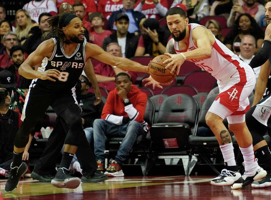 San Antonio Spurs Patty Mills knocks the ball from Houston Rockets Austin Rivers during the first half of NBA game at Toyota Center Wednesday, Oct. 16, 2019, in Houston. Photo: Melissa Phillip, Staff Photographer / © 2019 Houston Chronicle