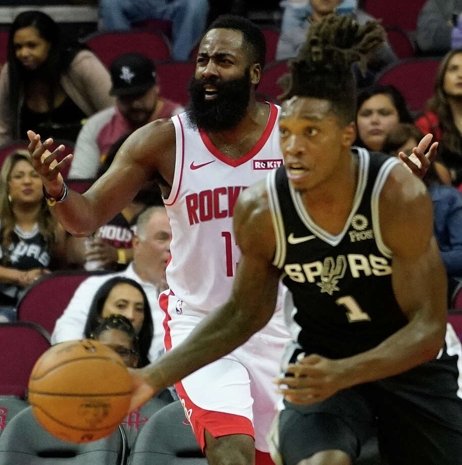 San Antonio Spurs Lonnie Walker IV takes the ball down court as Houston Rockets James Hardin questions the lack of a foul call during the first half of NBA game against the San Antonio Spurs at Toyota Center Wednesday, Oct. 16, 2019, in Houston. Photo: Melissa Phillip, Staff Photographer / © 2019 Houston Chronicle