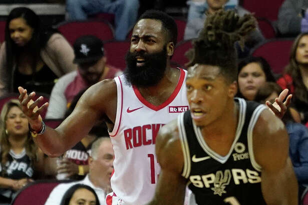 San Antonio Spurs Lonnie Walker IV takes the ball down court as Houston Rockets James Hardin questions the lack of a foul call during the first half of NBA game against the San Antonio Spurs at Toyota Center Wednesday, Oct. 16, 2019, in Houston.