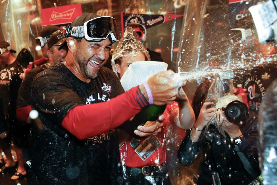 Washington Nationals manager Dave Martinez celebrates after Game 4 of the baseball National League Championship Series against the St. Louis Cardinals Wednesday, Oct. 16, 2019, in Washington. The Nationals won 7-4 to win the series 4-0. (AP Photo/Patrick Semansky)